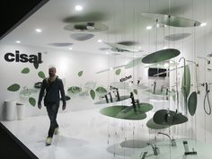 At the Cisal stand in Milan, nature is referenced through abstracted, green leaf-like forms