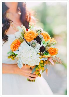 Orange Ball Dahlias, Chocolate Cosmos, Scabiosa Pods, Monkey Tails, White Hydrangea, Lissianthus and Spray Roses bouquet