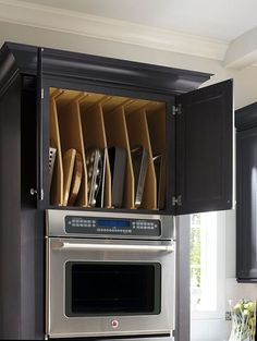 Over the microwave/oven storage for pans! So much better than the disaster under my stove!