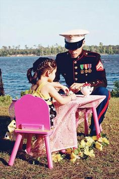 This cute picture shows a military dad playing tea party with his daughter. It shows that dads can play tea party and spend just as much quality time with their kids as the mothers.