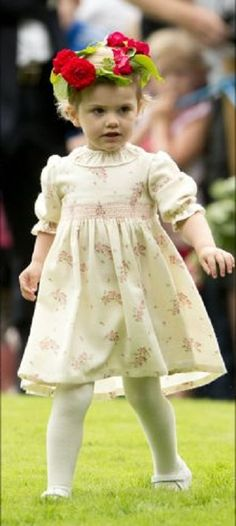 Adorable little Princess Estelle wearing flower hair wreath celebrating the 37th birthday 2014 of the Crown Princess at Solliden palace in Oland, Sweden.