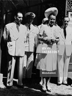 The wife of the Argentinian President Evita Peron is wearing an elegant dress with a hat during her visit to Italy together with her brother Juancito Duarte. Rome, 1947 Get premium, high resolution news photos at Getty Images Her Brother, Presidents, Stock Photos, How To Wear, Pictures, Image, Divas, Rome, Hat