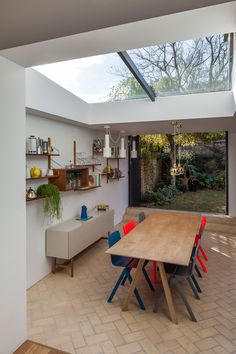 This room does a great job connecting the outside to the inside with the use of s herringbone tile floor and glass and a skylight