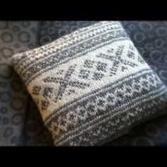 Knitted pillow case with traditional norwegian pattern