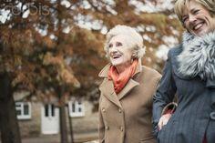 Senior woman and daughter walking outdoors
