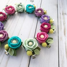Felt flower Single Poppy Hair Clip in Orchid Purple Meticulously handcrafted wool felt poppy flower adorned with felt berries surrounded by leaves & affixed to an alligator style clip. A beautiful accessory for little girls, teens or adults, absolutely charming as a pigtail set! These