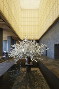 Aman Tokyo | Japan - Japanese Inner Garden with art installation and fresh flowers