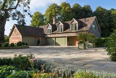 This project was led by London-based architect Oliver Morgan who invited Hartwood Oak Buildings to design and… Oak Framed Buildings, Timber Buildings, Unusual Buildings, Garage With Room Above, Timber Frame Garage, Oak Framed Extensions, Oak Frame House, Garden Room Extensions, Garage House Plans