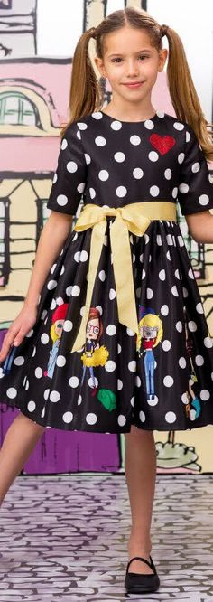 SALE !!! LOVE MADE LOVE Girls Designer Black Spotted Dress. Super fun dress for girly girls. The perfect black party dress with white polka dots and girls skating, walking dogs and taking photos. Love the glittering red heart on the chest. Now on Sale! #kidsfashion #fashionkids #girlsdresses #childrensclothing #girlsclothes #girlsclothing #girlsfashion #cute #girl #kids #fashion