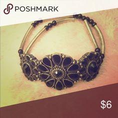 Pretty bracelet Black and silver stretchy brace with flower design. Jewelry Bracelets