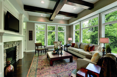 Big bright windows are the trend. They can even work in a more traditional style home like in this photo!