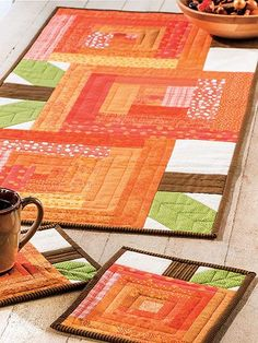 Quilting - Kitchen Patterns - Candle Mat, Coaster, & Mug Rug Patterns Bring a touch of autumn to your table with these fast and easy scrappy projects. Just think how great your table will look! Size: Table Runner - x and Mug Rug - x Skill Level: Beginner Halloween Sewing, Halloween Quilts, Mug Rug Patterns, Quilt Patterns, Pattern Books, Christmas Mug Rugs, Christmas Quilting, Fall Quilts, Quilted Table Runners