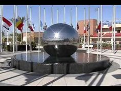 First Monumental Revolving Stainless Steel Globe, 96 inches in diameter, fabricated with all the stone surround walls and stone benches, for Chapman Universi. Water Fountain Design, Stone Bench, Water Features In The Garden, Landscape Design, Waterfall, University, March, Stainless Steel, Sculpture