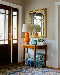 entryway by interior designer Katie Rosenfeld. The whole entryway is a bit much, but there are so many things I like about this! Fancy Living Rooms, My Living Room, Living Room Decor, Ginger Jar Lamp, Ginger Jars, Style At Home, Orange Lamps, Orange Orange, Teal Yellow