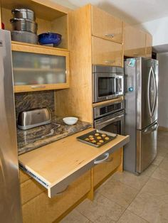 Looking for Contemporary Kitchen and Small Kitchen ideas? Browse Contemporary Kitchen and Small Kitchen images for decor, layout, furniture, and storage inspiration from HGTV. Kitchen Redo, Kitchen Dining, Kitchen Cabinets, 1960s Kitchen, Ranch Kitchen, Kitchen Island, Narrow Kitchen, Kitchen Countertops, Long Kitchen
