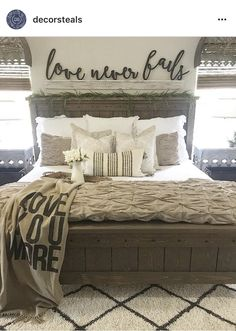 The wooden words on the wall behind the bed ❤️ I love these words Eric!
