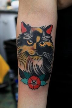 Old school coloured cat forearm tattoo
