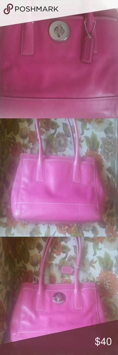 Pink coach bag Pink/fuchsia color,  leather med gently loved Coach Bag.  A couple of marks on outside of bag, super clean inside. Coach Bags Shoulder Bags