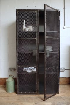 This industrial mesh cupboard is spacious and hard wearing. Ample storage space for anywhere in the home. Three shelves and two locking doors with rivet detailing. Distressed metal and grey paint finish. Industrial Design Furniture, Industrial Storage, Industrial Living, Industrial Style, Furniture Design, Metal Industrial, Industrial Lamps, Pipe Furniture, Furniture Vintage