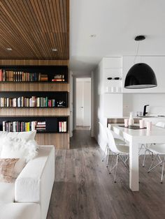 Love the wooden library room and the white contrast.