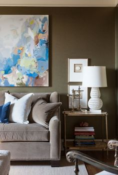 Our living room has lots of seating. My husband, Mark, jokes that I collect old chairs. This incredible painting by Christina Baker brings t...