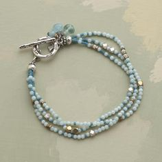"""Sunlit Sea Bracelet  Handmade brass beads cast flashes of sunlit brilliance within strands of amazonite and aquamarine. Toggle is sterling silver. Clasp dangles a flourish of fluorite, amazonite and aquamarine gems. Exclusive. Approx. 7-1/2""""L.  Read Our Product Story"""