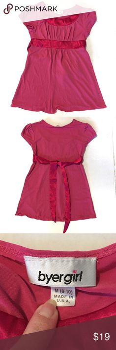 Byer Girl Size 8-10 Pink top that ties in back Byer Girl Size 8-10 Pink top that ties in back. Gently used dressy girls top. In great condition! Top is polyester and spandex, ties are polyester. Lighter pink color has a very faint sparkle to the fabric (when you look up close). Byer Girl Shirts & Tops Blouses