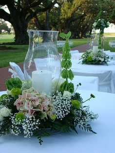 wedding centerpiece with pillar candle and hurricane shade