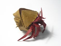 Intruder on the crab board! That hermit crab is made of paper! #origami
