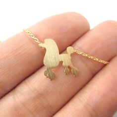 If youre a fan of French Poodles you might just like this simple yet elegant necklace made with a pendant in the shape of a French Poodle in gold!