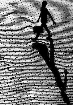 shadow | brick road | cobblestone | walking | vintage black and white photography | briefcase | shadows