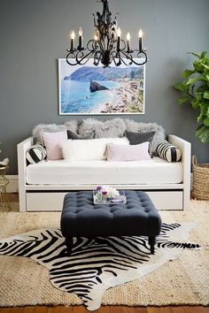 Meg's Classic Glamor Apartment: the colors are too reminiscent of a rainy London evening (pretty, but gloomy) and I dislike animal skin-print anything but I like the dark chandelier, tufted ottoman and all the different pillow textures on the daybed