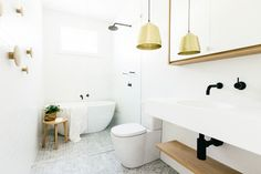 White and gray bath with black plumbing fixtures