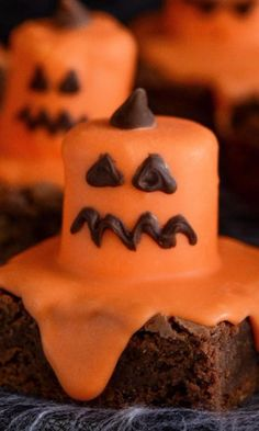 Melted Jack O' Lantern Brownies-Melting Jack-O-Lanterns drip their candy marshmallow goodness all over rich chocolate brownies. This kid-friendly dessert recipe will have your Halloween party-goers cackling with delight. These sweet treats will look spooktacular displayed on your buffet table and taste so good it's scary!