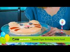 Learn how to create a Daniel Tiger cake and striped parfaits with this Daniel Tiger's Neighborhood birthday party tutorial from @Patti B Stamp Parents!
