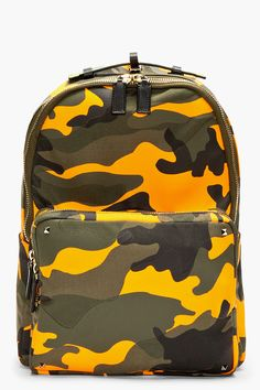 Textile leather-trimmed backpack in orange, khaki, green, and black. Camo print throughout with cutout patches.  http://www.zocko.com/z/JFEMx