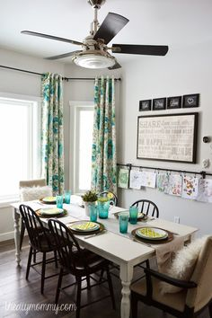 House of Turquoise: The DIY Mommy // Lovely room, but I especially like how she decided to hang the kids' pictures!