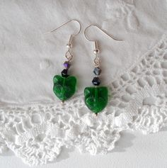 Halloween Green Pressed Czech Glass Cat Head Dangle Earrings with Swarovski 4 mm bicone beads by RicePaperJewels on Etsy