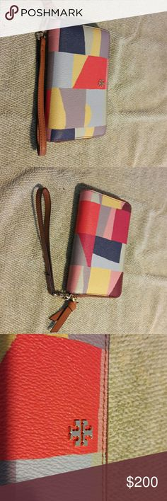 TORY BURCH wristlet Fabulous colors and designs. TORY BURCH wristlet. Never carried, brand new, and in pristine condition. Awesome for TORY BURCH lovers. Super cute and fun. Love this little wristlet.....AWESOME!!!! TORY BURCH  Bags Clutches & Wristlets