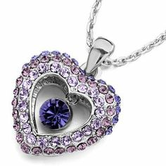 Pugster Heart Violet Light Amethyst Tanzanite Swarovski Crystal Dangle Round Pendant Necklace Pugster. $26.54. Quantity: 1 piece. Perfect gift for any occassion.. Materials: Austrian Crystal. Comes with a gift box.. An 18 inch chain is included.. Save 10%!
