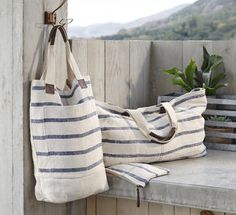 """Washed Linen totes. Perfect for the beach, market or just about anything.  Our totes are made of heavy weight linen that is enzyme washed for a vintage look and extra soft feel.  Deep Tote measures 15.5""""L x 19""""H Extra Large Tote measures 30""""L x 15""""H Each tote feature interior pockets and cotton lining"""