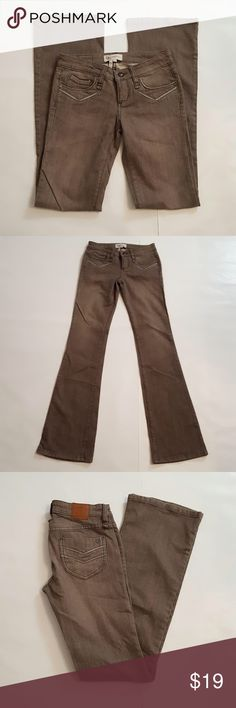 "BCBGeneration Flare Leg/Bootcut Jeans BCBGeneration Flare Leg/Bootcut Jeans. Low-rise. Size 25. 98% cotton, 2% spandex. Color: tan. Measurements: 27"" waist, 33"" hips, 40 1/2"" length, 33"" inseam. BCBGeneration Jeans Boot Cut"