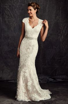 Wedding gown by Ella Rosa.