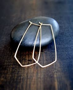 """Chevron hoops add a sophisticated polish to any out. Details: - Thin lightweight design - Handcrafted from your choice of solid 14K gold, 14K gold-fill or Argentium Silver - Dangles 2"""" from top to poi"""