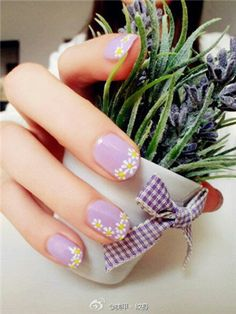 The most cutest spring nail art design I have ever seen lilac background colour and Daisy's