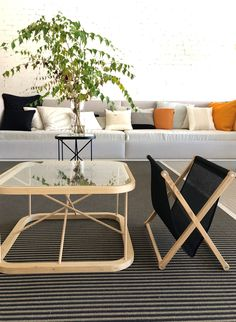 Woodnotes Twiggy oak table size 66,5x66,5x38,5 cm (in front) and black table size 44x44x45,5 cm together with Magazine rack oak frame with black bag size 50x32x45 cm.