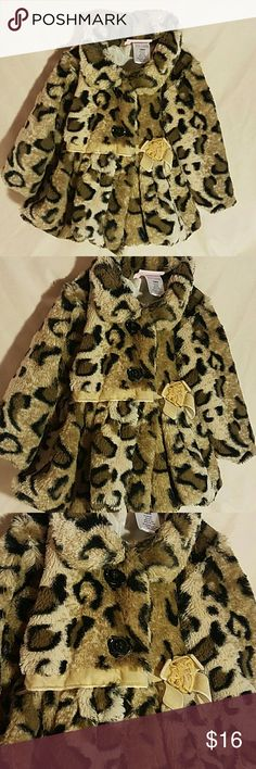 Little Lass animal print coat This coat is so adorable I want one for myself. Made of the absolute softest polyester in an animal print accented by a velvet ribbon at the front and small flower. 3 black buttons close the coat in the front. Fully lined. This coat is in perfect condition. Little Lass Jackets & Coats