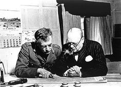 Strategists' Conference, WWII - Winston Churchill and Lieutenant General A.G.L. McNaughton study a military map at Canadian Headquarters, March 1941 (courtesy Library and Archives Canada/PA-119399).