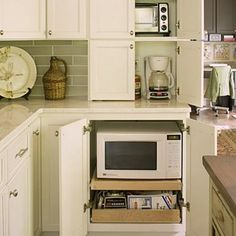 Dream Kitchen Design Ideas: Hidden Appliances < Dream Kitchen Must-Have Design Ideas - Southern Living An appliance garage keeps your most used appliances plugged in and ready to go without cluttering your countertop. Kitchen Appliance Storage, Appliance Garage, Kitchen Organization, Organized Kitchen, Appliance Cabinet, Kitchen Redo, Kitchen Remodel, Kitchen Cabinets, Kitchen Appliances