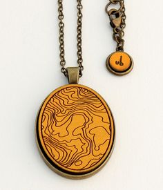 Topographic Map  - Laser Cut and Etched Necklace. $40.00, via Etsy.